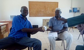 Wandifa handing over funding for the staff quarters