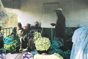 Mr Darboe of NARI talking to villagers