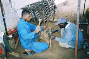 local workers making parts for the basketball posts