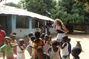 Helen blowing bubbles for the children at Wandifa's compound