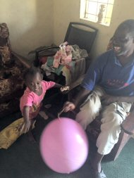 Little Mai playing balloon games with Wandifa