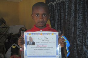 Alhagie with his scholarship certificate