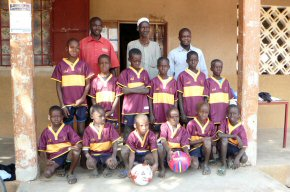 The football kit with the principal, vice principal and the village leader