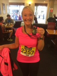 Carol with her medal after completing the Stafford half marathon