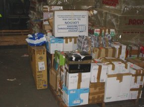 more cardboard boxes and other packages ready to be loaded into a container in the UK