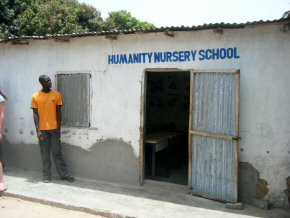 Wandifa outside the single school room