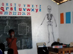 humorous skeleton behind the teacher's desk