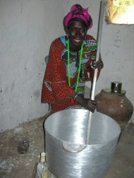 Ebrima's wife with her cooking pot