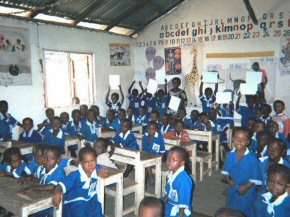 children with their new whiteboards in the classroom