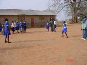 girls playing rounders in blue sports kit provided by Pageant