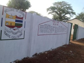 outside of the school wall, with school badge and welcome message