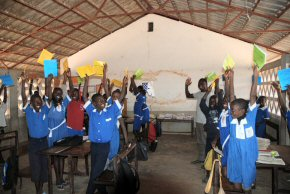 Each child in the school was given an exercise book and pencil