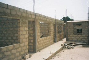 looking along the front - the small building at the right will be the school office
