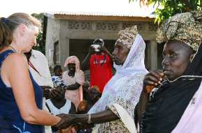 Pippa talking to the six village ladies who received loans 1