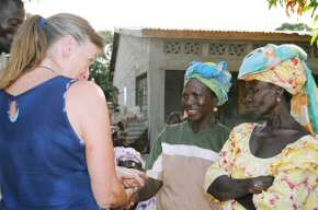 Pippa talking to the six village ladies who received loans 3