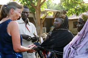 Pippa talking to the six village ladies who received loans 2