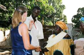 Pippa talking to the six village ladies who received loans 4