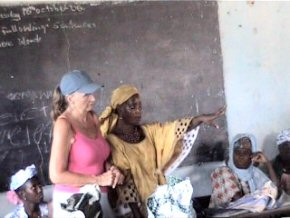 Pippa and Mariama explaining the loan scheme to the assembled ladies