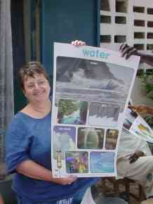 Linda displays a poster about water resources
