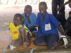 Modou Lamin at home with some of his family