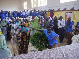 at Kalagi children and staff gather in an assembly hall