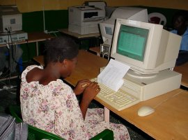 another girl student uses a computer at Crab Island