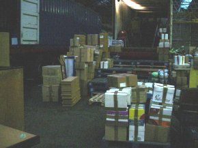 cardboard boxes and other packages waiting to be loaded into the container