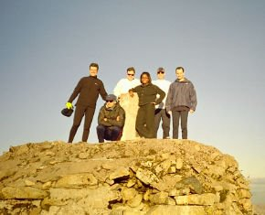 Chris and his party pose on the cairn at the top of Ben Nevis
