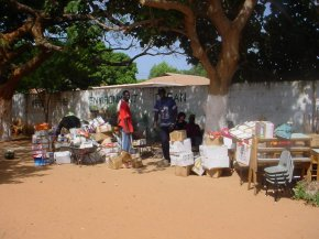 pacakages are stacked in the school compound at Bakau New Town
