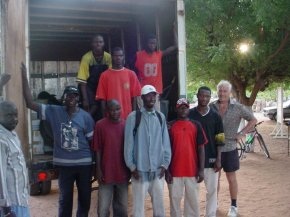 The Pageant unloading team pose at the back of the loaded up lorry