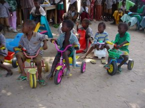Bakalarr Nursery children trying out tricycles from Bramley Nursery School