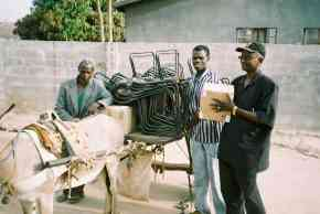 Wandifa with a donkey cart loaded with chairs and other goods