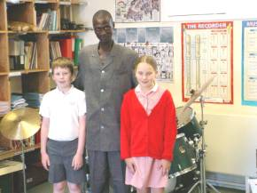 Bakary with the two pupils who took him around the school
