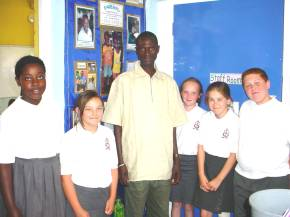 Bakary with some pupils in front of their Gambia board