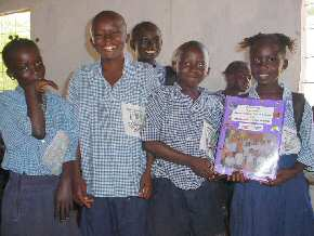 Abuko children  with the folder from Ridgemead Junior School