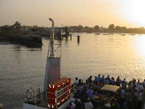 the Banjul-to-Barra Ferry arriving at dawn