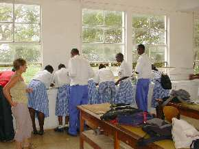 students of Gambia SSS using their microscopes on the window ledge 1