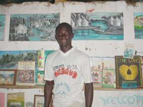 Ousman with some of his latest paintings