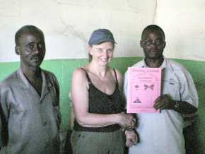 Pippa and staff of Crab Island with a copy of  'General Science' written by F. Sherrif, the teacher holding the book