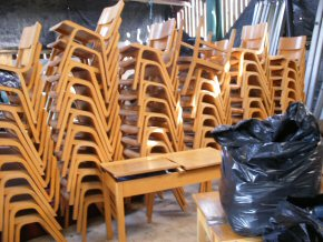 stacks of school chairs waiting to be packed