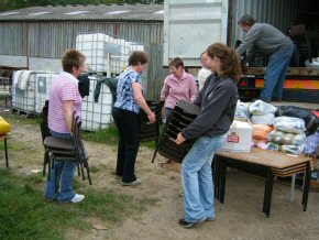 Sue, Kathy, Sandra, Jeremy, Helen & John loading the container
