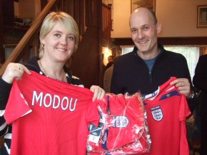 Rachel Day and husband Kevin holding some of the football shirts