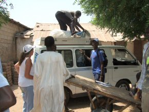 Abdoulie unloading the bundles of nets