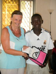 Modou Jeng gets his prize from Pippa