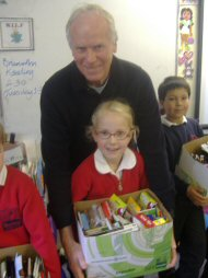 Brian and Ann and some pupils with some of the pencil collection