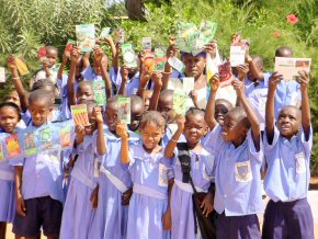 school children with packets of donated seeds