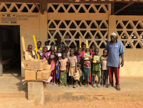 Children with their workbooks and pencils