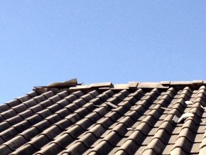 roof with damaged ceramic tiles