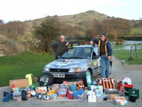 Nick & Tim with their car and supplies
