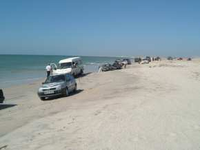 the convoy driving along the beach
